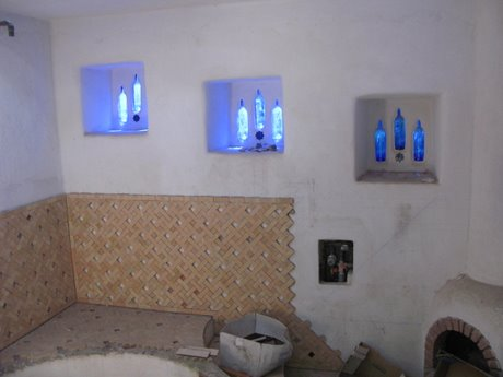 The bathroom inside, recycled wine organic wine bottles for windows