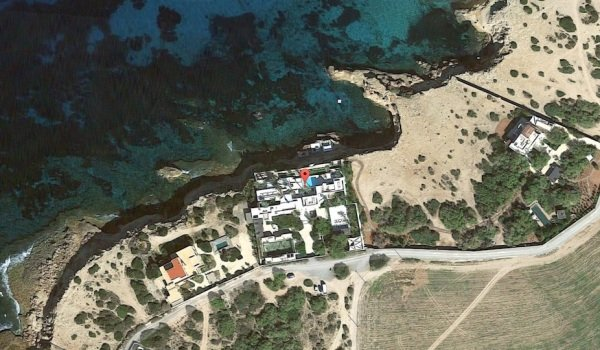 The villa in Ibiza, with the illegal chill-out area on the waterfront below.