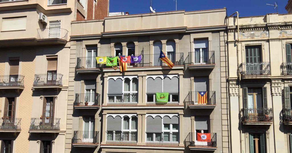Catalan independence flags and banners in favour of breaking away from Spain hang from balconies in Barcelona