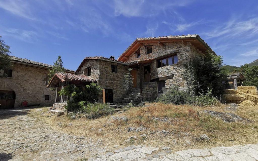 Spanish eco-village abandoned medieval hamlet restoration Spain.